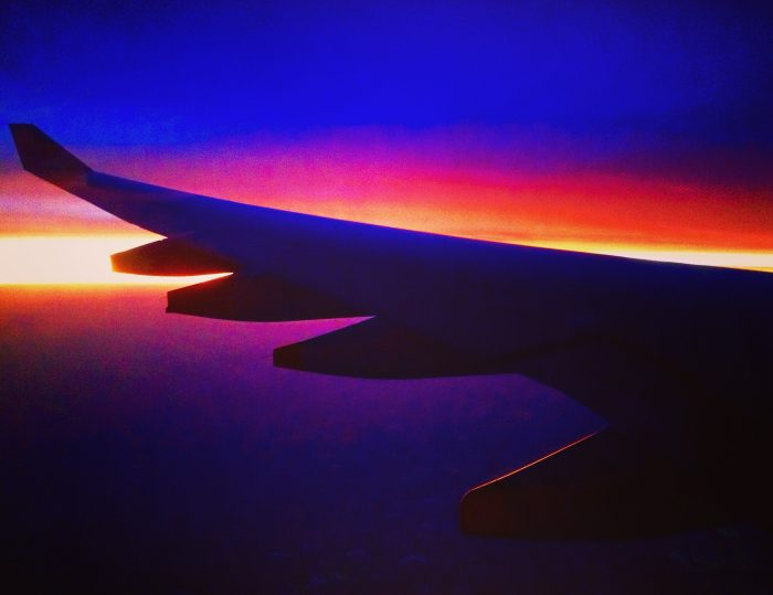 Why-Travel, pic of plane and sunset