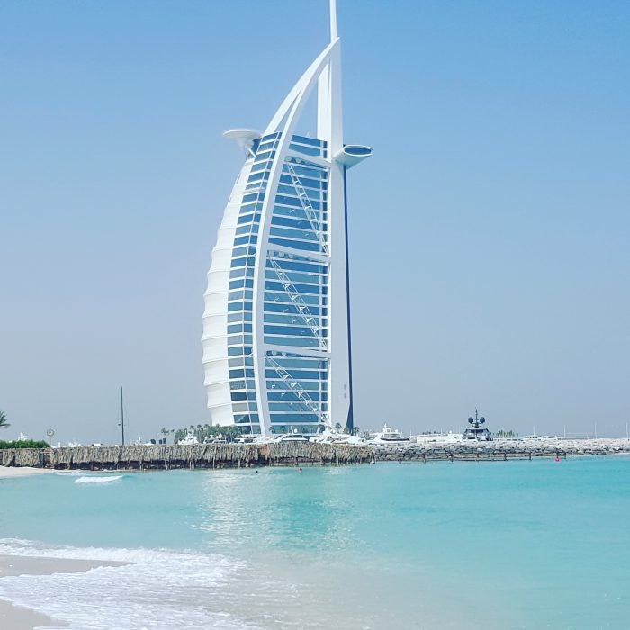 Why Travel, beach scene and hotel in Dubai