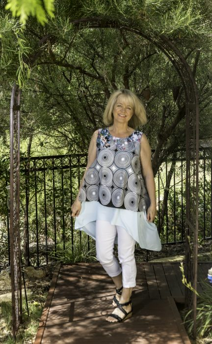 Fabulous style for women over 50. Mature women in white leggings and geometric top. Fifty Plus Women's Fashion ideas