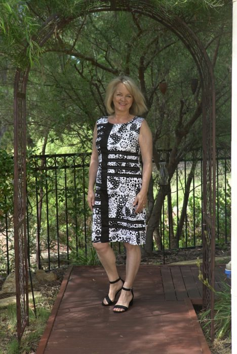 Woman in black and white dress. Fifty Plus Women's Fashion ideas