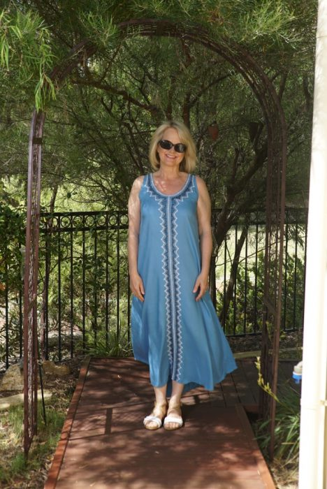 Fashion tips for women over 50 - woman in blue dress