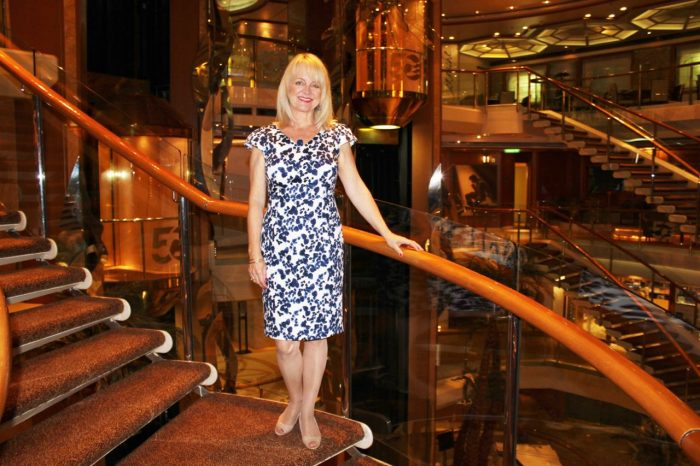 how-to-look-slimmer, lady in blue dress on a cruise ship