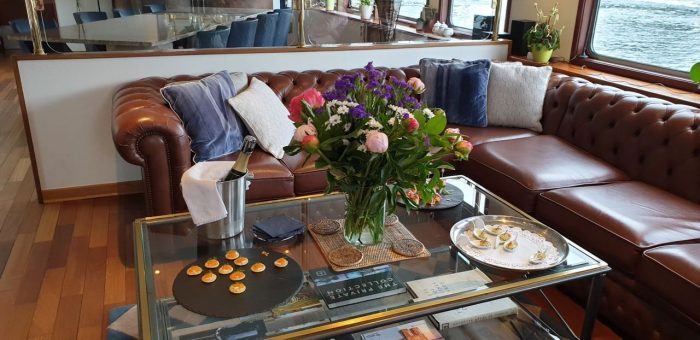 The saloon on Le Panache, luxury hotel barge on a canal trip in France