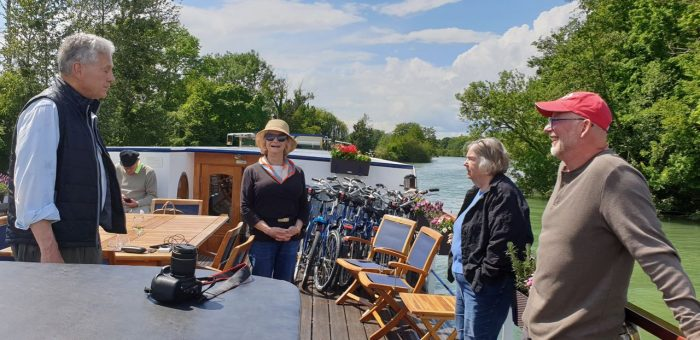 Canal trips in France. Friends on deck.