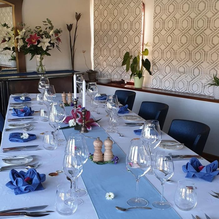 Table laid for dinner on Le Panache a luxury hotel barge. Barging in France is luxurious with European Waterways.