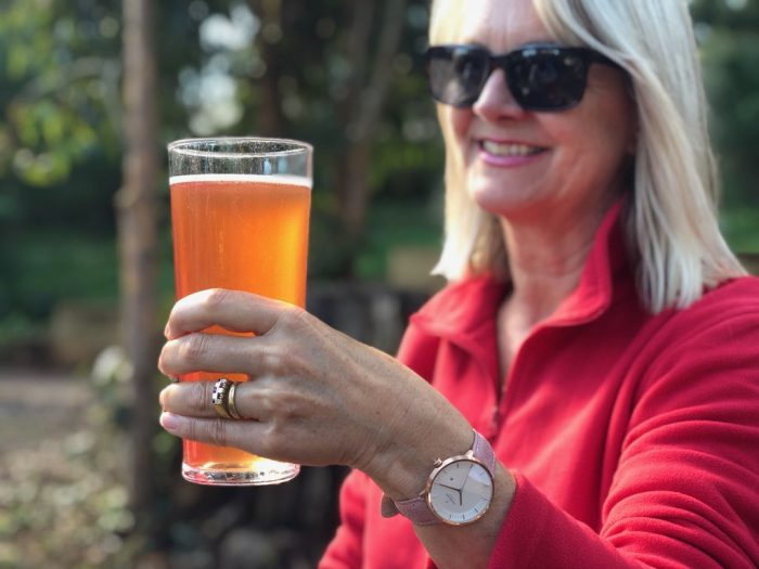 Woman holding a beer - fashion post