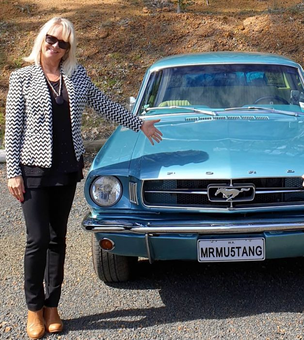 Woman showing off winter look and style - Mustang car - fashion post