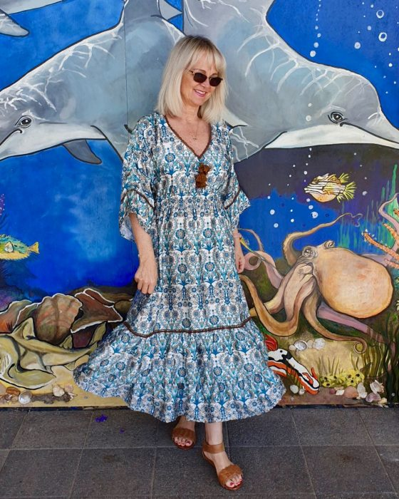 Image of woman by dolphin mural from the post Style Advice, Simple Fashion Tips