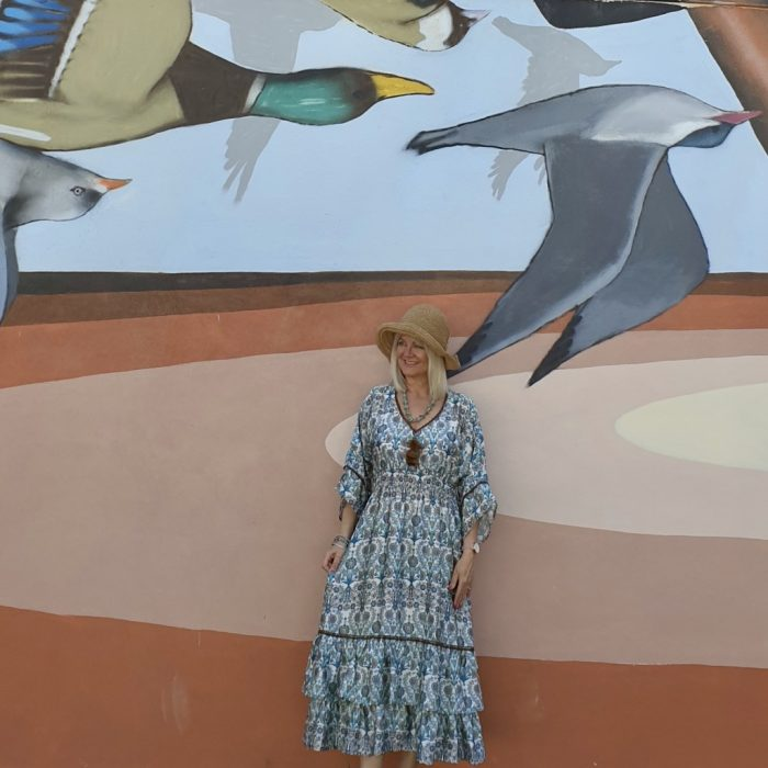 Image of woman by street mural, in post Style Advice, Simple Fashion Tips
