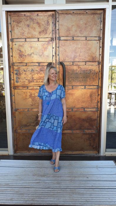 Woman in blue dress - what to pack for a tropical holiday to Bali