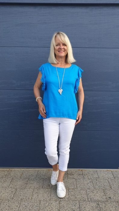 Woman in blue blouse. What to pack for tropical holiday.