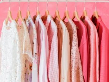 Clothes on hangers to illustrate post How to Look Fab if you're Plus Size
