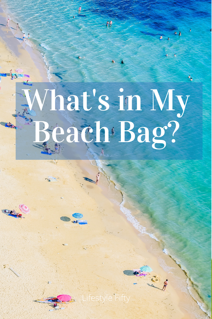 Beach Scene. Text overlay, What's in my Beach Bag? Essentials for Summer blog post.