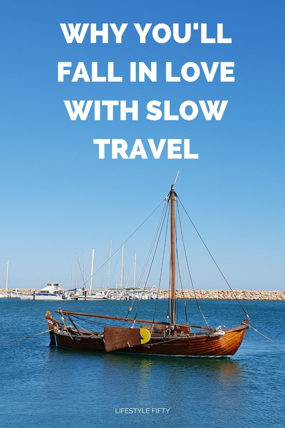 boat on a blue sea, text overlay, 'why you'll fall in love with slow travel,'