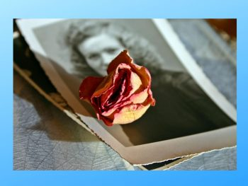 Sepia tinted photo of woman with a faded rose on the photo. From the blog post Life After 50.